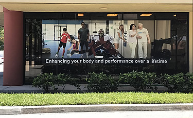 Actual gym studio window with the banner graphic